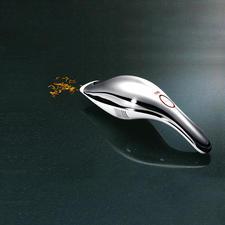 Aspirateur de table Alessi - Design élégant. Débarrasse en un seul mouvement des miettes, de la poussière & des petites flaques.