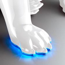 Lorsque l'Aerobull est allumé, le bord de sa patte s'illumine en bleu, forme sphérique.