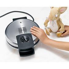 Un ventilateur intégré permet au couvercle du haut (Cromargan®) de rester froid : aucun risque de brûlure.