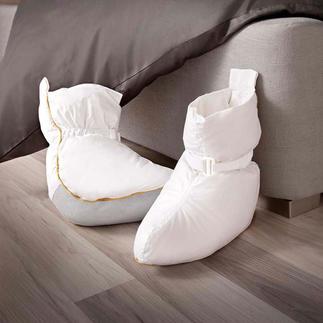 Les chaussons de lit Les chaussons de lit (garnissage 120 g 1/2 duvet) procurent immédiatement une agréable chaleur.