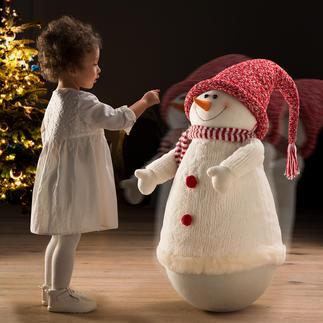 Bonhomme de neige à bascule Difficile de passer à côté de ce bonhomme de neige tout en rondeurs sans avoir envie de le pousser.
