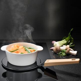 Plaque adaptateur 2-en-1 Pour adapter vos casseroles favorites à l'induction et maintenir vos plats au chaud sur la table.