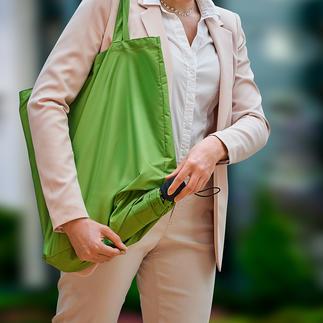 Parapluie de poche durable Un ingénieux 2-en-1 : sac de courses et parapluie de poche. Fabrication durable en plastiques recyclées.