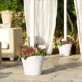 Pot à fleurs à 360° D'ingénieux pots à plantes à 360° entourent vos piliers, poteaux et gouttières d'une floraison luxuriante.