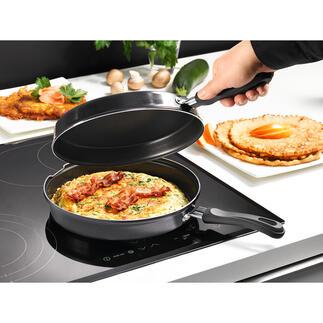 Poêle double à induction La double poêle pour préparer omelettes et crêpes proprement. Maintenant disponible pour tous les types de plaques de cuisson, même l'induction.