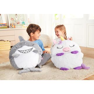 Sac de couchage et couverture licorne ou requin Pour jouer, se blottir ou dormir : en quelques secondes, cette peluche se transforme en sac de couchage.