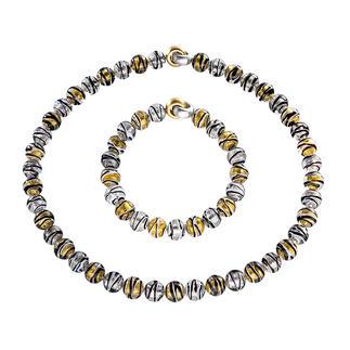 Collier ou Bracelet en perles de Murano Splendeur vénitienne : l'éclat de l'or et de l'argent saisi dans des perles en verre de Murano.