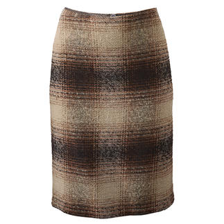 Jupe à carreaux bouclée Nouveau look pour la jupe classique à carreaux : une structure bouclée.