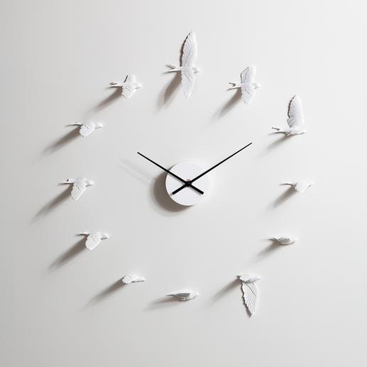 Pendule hirondelles Un envol d'hirondelles vous indique l'heure. Belle imitation du vol d'un oiseau.