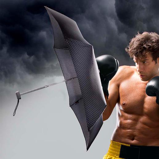 Mini parapluie en acier carbone Un véritable poids plume. Avec dôme de grande envergure. Résiste à des rafales de vent jusqu'à 80 km/h.