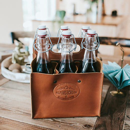Porte-bouteilles en cuir de buffle Le porte-bouteilles stylé en cuir de buffle rustique. Fait à la main en Allemagne.