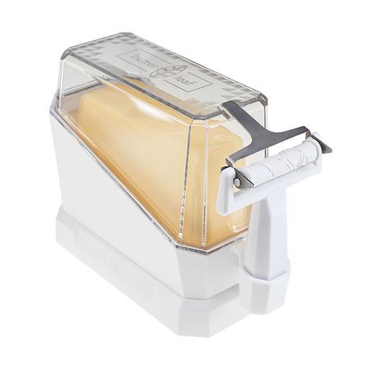 Astucieux: au moment de servir, le couvercle devient un support, qui amène le beurre dans la bonne position pour le tranchage.