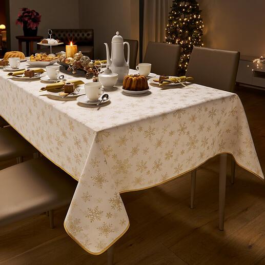 Nappe de Noël damassée Festive, mais pas trop solennelle. Avec une bordure incluse dans la trame et des flocons de neige scintillants.