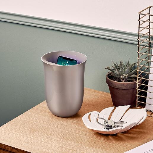 Station de charge à induction et de désinfection Aussi décorative qu'un vase, cette station de recharge à induction moderne est également un stérilisateur UV.