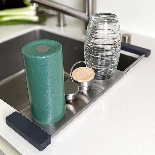Support pour évier Drip-it Le support parfait pour torchon et bouteille. Et en même temps une solution multifonctionnelle pour l'égouttement et l'organisation au niveau de l'évier.