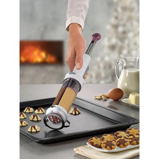 Presse à biscuits à 2 chambres Réussissez vos biscuits marbrés ou sablés en un mouvement. Par Betty Bossi, le spécialiste suisse des accessoires de cuisine et de pâtisserie.