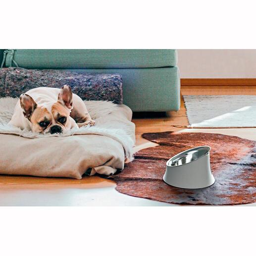Gamelle pour chien asymétrique par Alessi Permet à l'animal de se nourrir proprement et réduit ostensiblement le travail de son maître.
