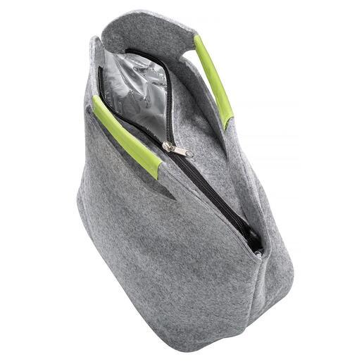Vous ouvrez facilement le sac à l'aide de la fermeture à glissière et le remplissez confortablement par le haut.
