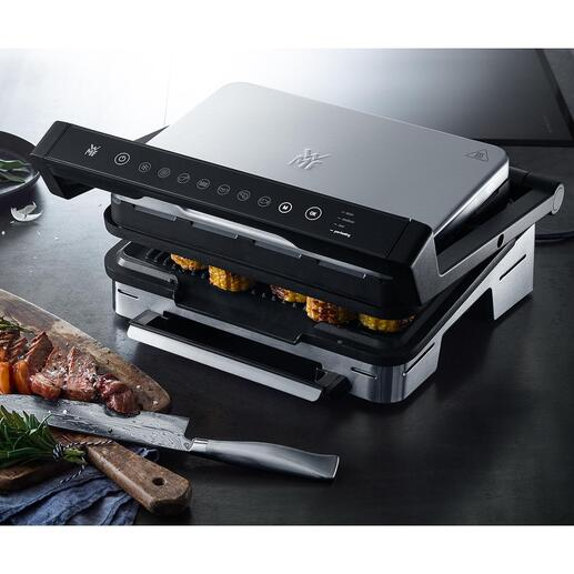 Gril de contact/de table Perfection par WMF Un appareil entièrement automatique pour des poissons, viandes, panini (etc.) grillés parfaitement, selon vos envies. Design et matériaux de qualité par WMF.