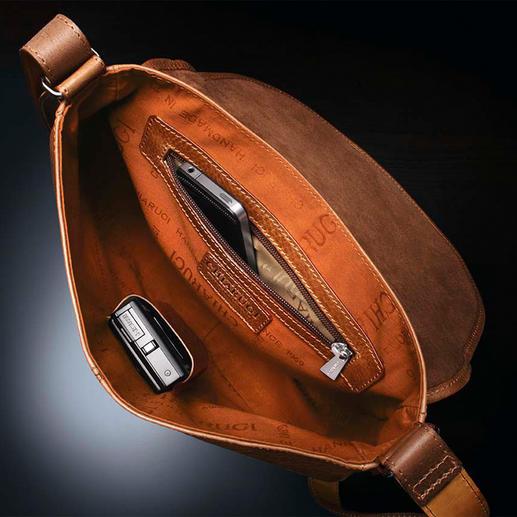 Intérieur spacieux avec compartiment ouvert et compartiment zippé.