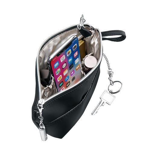 Avec le Bag'nBag, vous transfèrerez tous vos objets d'un sac à main à l'autre en un tour de main.