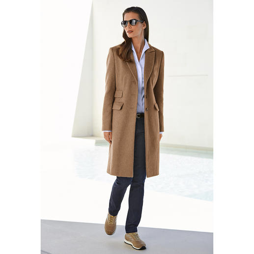 Manteau en poil de chameau Seuls quelques manteaux possèdent le potentiel pour devenir des classiques intemporels.