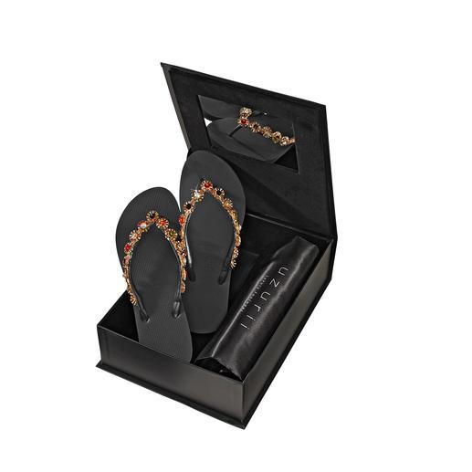 Sandales entre-doigts glamour Uzurii Autrefois une simple chaussure de plage, aujourd'hui, star incontestée de la mode.
