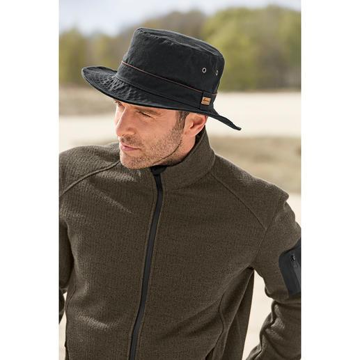 Chapeau intempérie en coton Herman En pur coton. La micro-cire spéciale le rend déperlant et coupe-vent, tout en étant respirant.