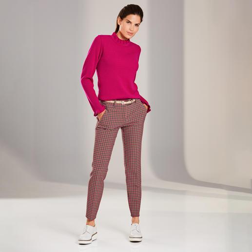 Pullover à volants Volants, mélange de motifs, couleur pop brillante : 3 tendances – sans être criard pour autant.